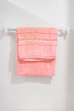 Towel on hanger. White and pink towel on hanger Royalty Free Stock Photography