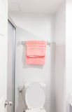 Towel on hanger. White and pink towel on hanger Royalty Free Stock Photo