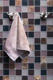 Towel hanging on a hook Stock Photos