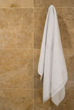 Towel hanging. On wall with copy space Stock Image