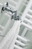 The towel hangs on a hanger. In a bathroom Royalty Free Stock Photos