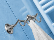 The towel hangs on a hanger Royalty Free Stock Images