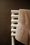Towel on heater. A Towel on heater in the bathroom stock photo