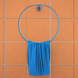 Towel on the holder on the background tiles. 3d rendering.  Stock Photography