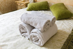 Towel in Hotel bedoom. Welcome guests, room service. Towels in Hotel room. Closeup of hotel bedroom towels, selective focus. Welcome guests. Room service. White Royalty Free Stock Image