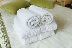 Towel in Hotel bedoom. Welcome guests room service. Towels in Hotel room. Closeup of hotel bedroom towels, selective focus. Welcome guests. Room service. White Royalty Free Stock Photos