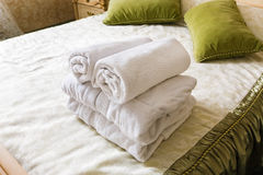 Towel in Hotel bedoom. Welcome guests room service Royalty Free Stock Photos