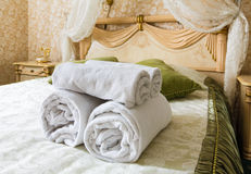 Towel in Hotel bedoom. Welcome guests room service. Towels in Hotel room. Closeup of hotel bedroom towels, selective focus. Welcome guests. Room service. White Royalty Free Stock Photo