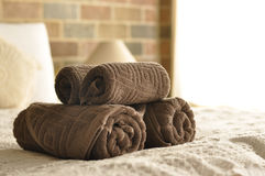 Towel in Hotel Room. Hotel towel on th bed Royalty Free Stock Photography