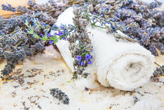 Towel with lavender and sea salt. On the mat Stock Photos