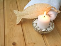 Towel,luffa wisp and burning candle Stock Photography