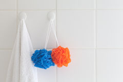 Towel and mesh bath sponges royalty free stock photo