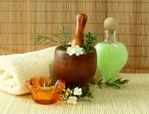 Towel, mortar, bottle and flowers Stock Image