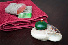 Towel, natural soaps and candles Stock Photography