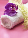 Towel and orchid Stock Image
