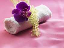 Towel and orchid Royalty Free Stock Photos