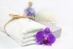 Towel and orchid spa bath concept Royalty Free Stock Images