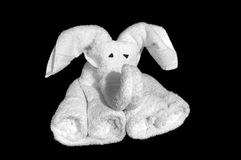 Towel Origami. White towel folded into an origami elephant isolated on a black background Stock Photography