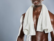 Towel over shoulders of muscular smiling man Royalty Free Stock Photography