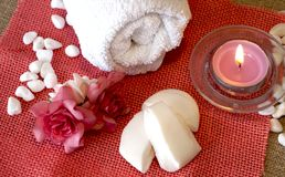 Towel, perfumed candle and soap preparing for spa treatment. White towel, perfumed candle and soap preparing for spa treatment royalty free stock photo