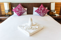 Towel and pillow in bedroom Stock Image