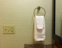 Towel rack. White towel and towel rack on wall Stock Photo