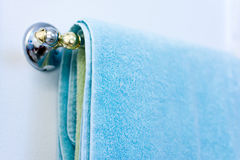 Towel on the rail in bathroom Stock Photo