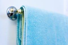 Towel on the rail in bathroom Stock Photo