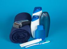 Towel, the razor, cosmetics, toothbrush and paste Stock Images