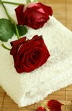 Towel and red rose. Royalty Free Stock Photos