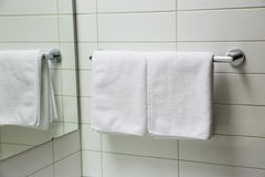 Towel with reflection in the mirror. Towel and it reflection in the mirror Royalty Free Stock Photo