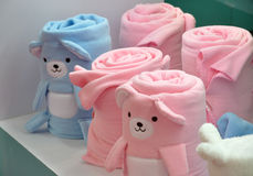 Towel roll for children. Lovely towel roll for baby or children in light blue and pink, shown as children taking care or home object providing Royalty Free Stock Images