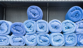 Towel roll stack on shelf Stock Image