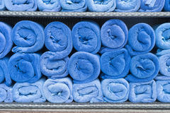 Towel roll stack on shelf Royalty Free Stock Photography