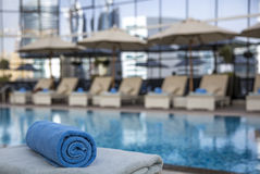 Towel rolled up ready for guests at a swimming pool in an early stock photography