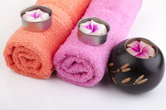 Towel rolls with flower candles and woodcraft Royalty Free Stock Photo