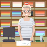 Towel saleswoman behind the counter Royalty Free Stock Photo