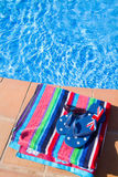 Towel and sandals  near pool Stock Images
