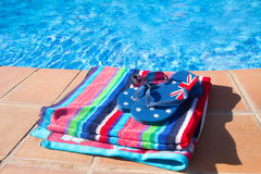 Towel and sandals  near pool Stock Image