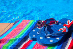 Towel and sandals  near pool Stock Photography