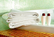 Towel, shampoo and gel in a bathroom Royalty Free Stock Image