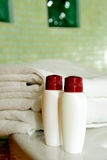 Towel, shampoo and gel in a bathroom Stock Images