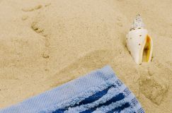 Towel and shell Royalty Free Stock Images