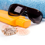 Towel, shells, sunglasses and lotion Royalty Free Stock Photos