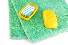 Towel and soap Stock Images