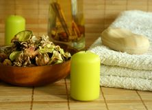 Towel, soap, candle and natural herbal ingredient. Royalty Free Stock Photos