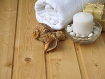 Towel,soap,candle and shells Stock Image