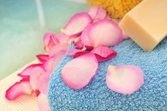 Towel, soap and rose petals Royalty Free Stock Photography