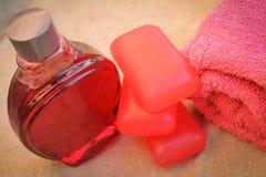 Towel, soap, shampoo. Towel, soap and shampoo on the background of burlap Royalty Free Stock Photo