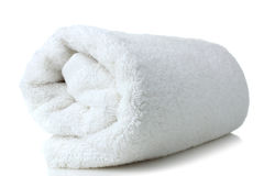 Towel. Soft bath towel rolled up on a white isolated background stock photos